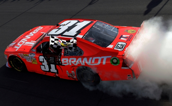Justin Allgaier celebrates a NASCAR Nationwide Series win at Montreal in 2012.