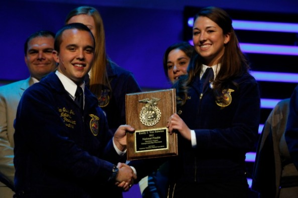 Ken Quick, 2011-12 National Eastern Region Vice President, shakes hands with Emily J. Von Edwins, a national finalist in veterinary science at the 85th National FFA Convention & Expo.