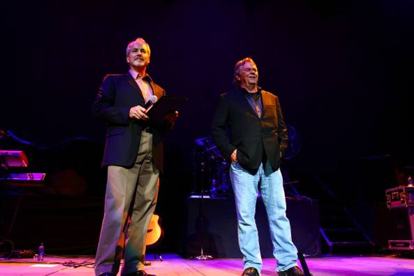 RFD-TV founder Patrick Gottsch (right) and National FFA Organization's Bill Stagg stand on stage during Wednesday night's FFA concert.