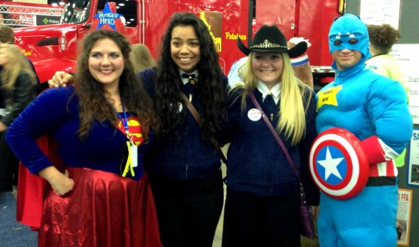 """FFA members pose with some """"Hunger Heroes"""" in the National FFA Expo."""