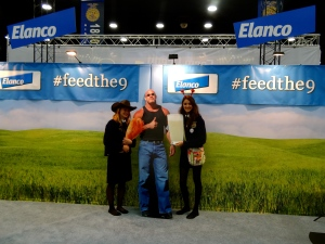 Brooklyn Stall (left) and Maddison Clements (right), from the Jefferson FFA Chapter in Missouri, help share Elanco's #feedthe9 message.